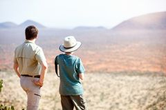 Family safari in Africa. Family of father and child on African safari vacation enjoying view over Samburu Kenya Stock Image