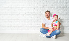 Family father child daughter at a blank white brick wall Stock Photos