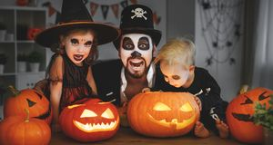Family father and children in costumes and makeup to halloween w Royalty Free Stock Images
