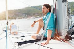 Family on board of sailing yacht. Family of father and daughter on board of sailing yacht enjoying sunset stock photo