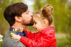 Family. Father and daughter. Kiss Stock Photo