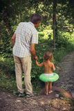 The family father and daughter outdoors. Stock Photo