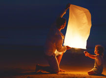 Family  father and daughter, send air heavenly flashlight lamp in flight Stock Images