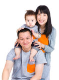 Family with father giving piggyback with baby son Royalty Free Stock Images