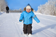 Family, father and happy small child the boy on walk in the wint Royalty Free Stock Photos