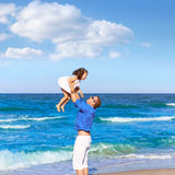 Family father holding daughter playing beach Royalty Free Stock Photography