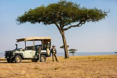 Family safari. Family of father and kids on African safari vacation enjoying morning game drive stock photos