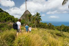 Family hiking. Family of father and kids hiking on summer day at tropical island of St Lucia in Caribbean with amazing views to iconic Pitons mountain stock photo