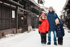 Family in Takayama town. Family of father and kids at old district of historical Takayama town in Japan on winter day Stock Image