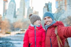 Adorable little girl and dad have fun in Central Park at New York City stock images