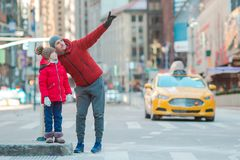 Family of father and little kid on Times Square during their vacation in New York City. Family of father and his little daughter on Times Square on Manhattan in stock photography
