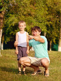 Family Father Man and Son Boy Child playing Outdoor Stock Image