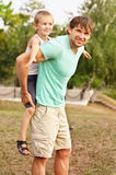 Family Father Man and Son Boy Child playing Outdoor Happiness emotion Stock Image