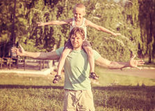 Family Father Man and Son Boy sitting on shoulders Outdoor. Happiness emotions Lifestyle with summer nature on background stock image