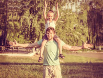 Family Father Man and Son Boy sitting on shoulders Outdoor Royalty Free Stock Photography