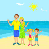 Family, father, mother, son and daughter on the beach Royalty Free Stock Image