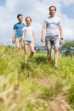 Family outdoors. Family of father and two kids enjoying peaceful walk outdoors on summer day stock images