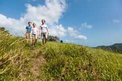 Family outdoors. Family of father and two kids enjoying peaceful walk outdoors on summer day stock photography