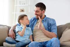 Father and son doing high five at home Stock Photos