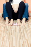 Family feet with baby shoes. In home stock photography