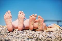 Family feet on beach background Stock Photography