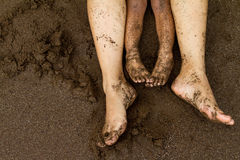 Family feet on beach sand Royalty Free Stock Photo