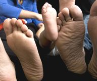 Family Feet, Father, Mother and Baby. This is a photograph of a Father, Mother and their Baby's feet Stock Image