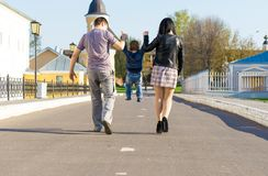 Father, mother and son walking in an urban neighborhood. Family feet and legs in jeans. Father, mother and son walking in an urban neighborhood Royalty Free Stock Photography