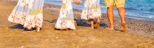 Family feet and legs on the sand beach. Stock Images