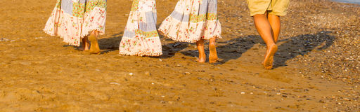 Family feet and legs on the sand beach. Stock Photo