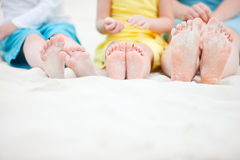 Family feet on sand Royalty Free Stock Photography