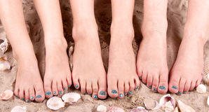 Family with feet in sand Stock Photos