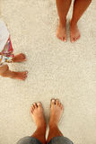 Family feet on the sand on the beach Royalty Free Stock Image