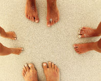 Family feet on the sand on the beach Royalty Free Stock Images