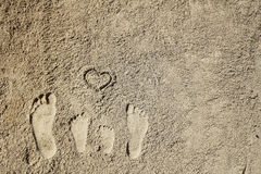 Family feet on the sand on the beach Royalty Free Stock Photos
