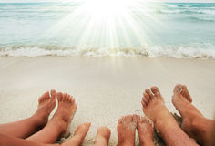 Family feet on the sand on the beach Stock Image