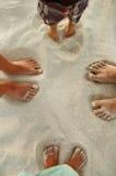 Family feet on the sand. On the beach Stock Photography