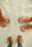 Family feet on the sand on the beach family Royalty Free Stock Image
