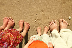 Family feet on the sand on the beach Stock Photography