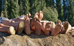Family feet at the sandy beach Royalty Free Stock Photos