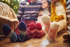 Family feet in wool socks Stock Photos