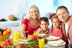 Family by festive table stock photo