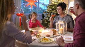 The family at the festive table with wine glasses. stock video footage