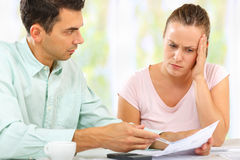 Family feud. Man and women worried and calculating their expenses Royalty Free Stock Images