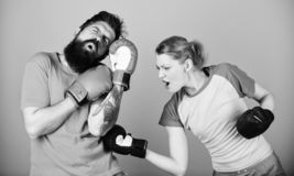Family fight. knockout and energy. couple training in boxing gloves. training with coach. Happy woman and bearded man royalty free stock photo