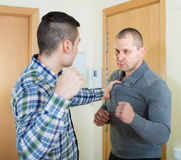 Family fight between two brothers. Family fight between two quarreling brothers at home royalty free stock photos