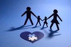 Family figure with jigsaw puzzle heart Royalty Free Stock Photos