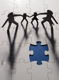 Family figure on puzzle board Stock Images