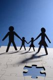 Family figure on puzzle board Royalty Free Stock Photo