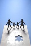 Family figure on puzzle board royalty free stock image